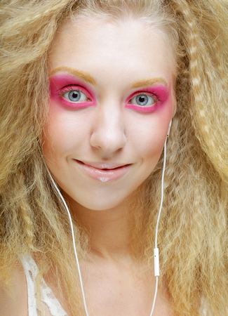 young woman dancing to music on her headphones Фото со стока