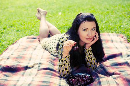 woman laying on  the grass Фото со стока