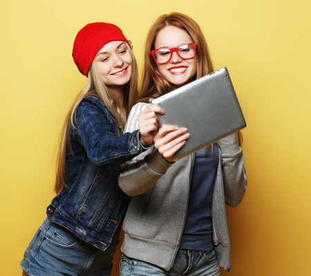two hipster girls friends taking selfie with digital tablet Banco de Imagens