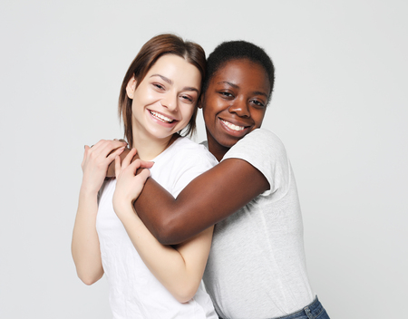 Shot of happy interracial couple hugging