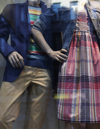 Fancy clothing on mannequins in window