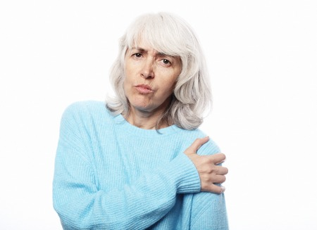 woman looks at the hand problem pain