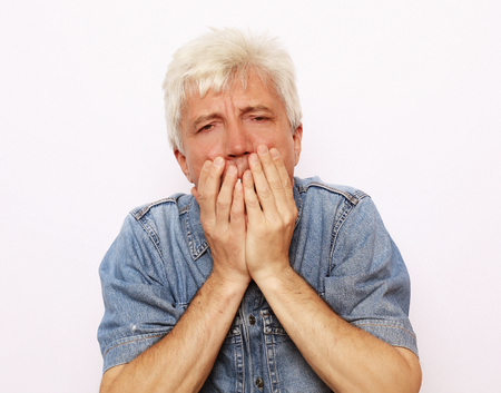 lifestyle and people concept: scared old man Stock Photo