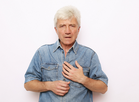 Old man holding breast because of heart infarction