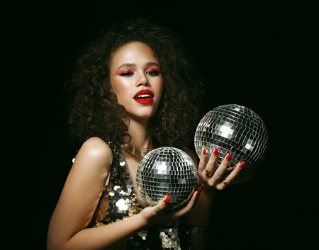 beautiful african woman with creative  make up and disco balls