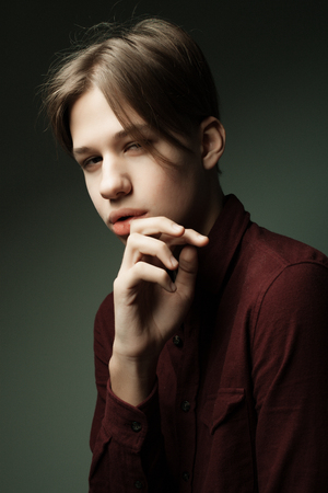 lifestyle and people concept - Portrait Of Serious Teenage Boy Stock Photo