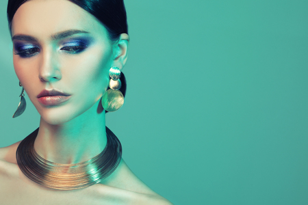 High Fashion model woman in colorful bright lights posing in studio. Stock Photo - 124758259