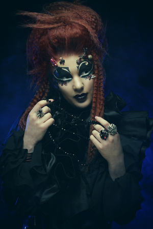 Gothic witch. Dark woman.Halloween picture Banco de Imagens