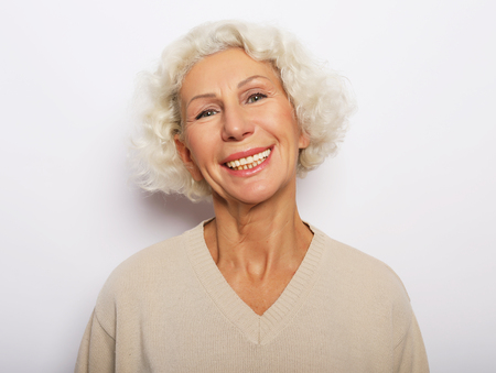 lifestyle, emotion and people concept: Close up portrait of happy senior woman smiling Stock Photo