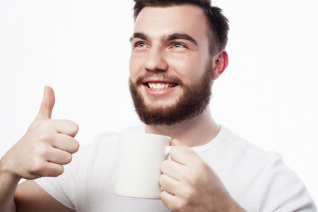 Good morning, man holding a cup tea. Morning concept.