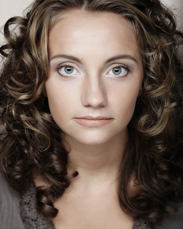 young woman with cury hair Stock Photo