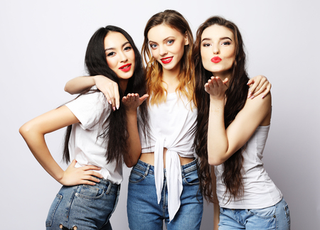 lifestyle, fashion and people concept - group of three girls friends wearing casual Reklamní fotografie