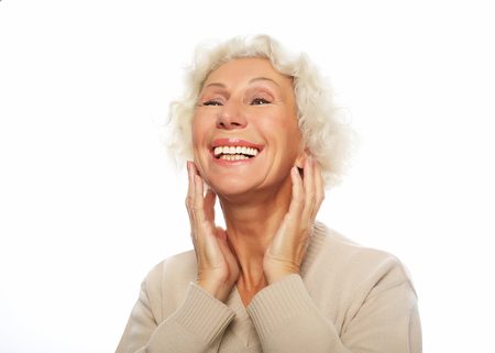 lifestyle, emotion and people concept: Close up portrait of happy senior woman smiling Banco de Imagens