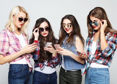 happy women friends sharing social media in a smart phone Stok Fotoğraf
