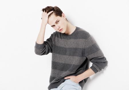 Attractive teenage boy posing in studio