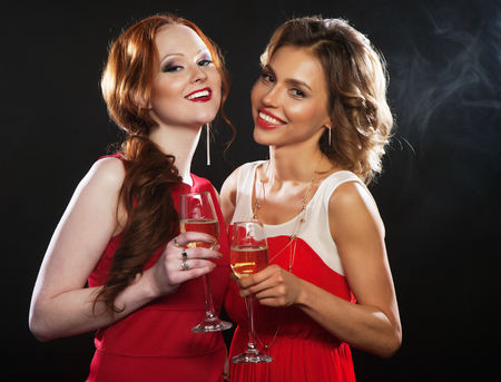 two beautiful young women with wine glasses
