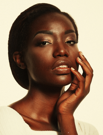 Portrait of Young African model with a beautiful makeup in studio
