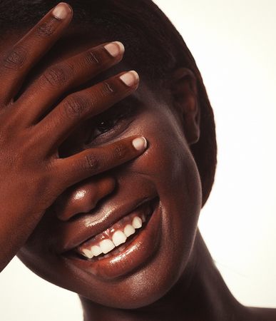 lifestyle and people concept:  young african woman laughing with her eyes closed Imagens