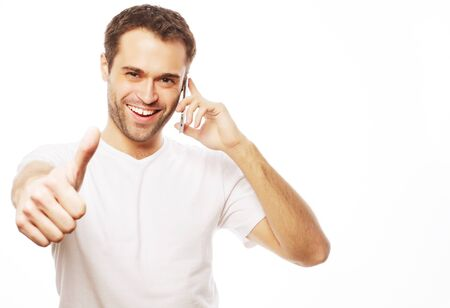 casual young man showing thumbs up sign Foto de archivo - 124816235