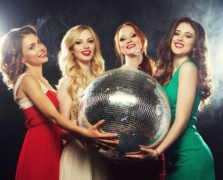 lifestyle, party and people concept - Party girls with disco ball, happy and smile.