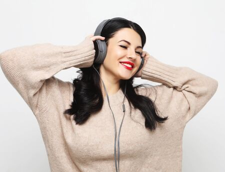 pretty woman plus size listening to music