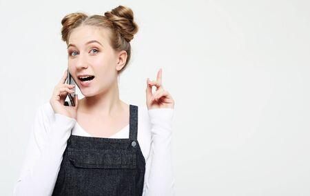 beautiful cheerful woman talking on mobile phone Stock Photo