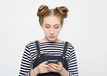 lifestyle  and people concept: Portrait of a happy young teenage girl  using mobile phone Stock Photo