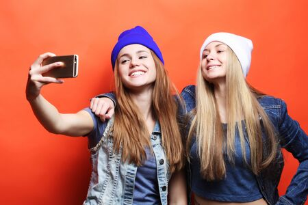 two young hipster girls friends  taking selfie Stock Photo