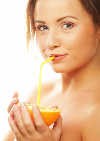 Beautiful young woman drinking juice with straw