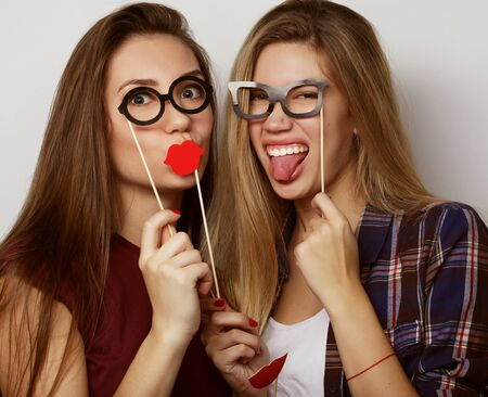 two stylish hipster girls best friends ready for party, over white background