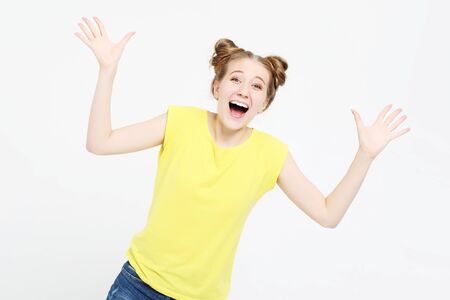 Image of excited screaming young woman standing isolated over white background Stock fotó