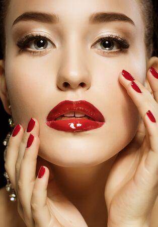 Luxury Woman, jewelery earrings. Fashion Brunette Portrait isolated on black background.