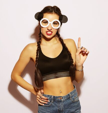beauty and fashion concept: young woman with creative sunglasses 写真素材