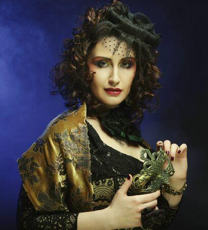 Close-up portrait of a beautiful   woman  with carnival mask Standard-Bild - 129245182