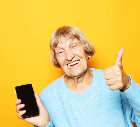 A picture of mature woman with new smartphone.