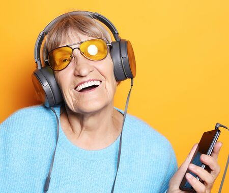 senior woman listening to music with smartphone Stock Photo