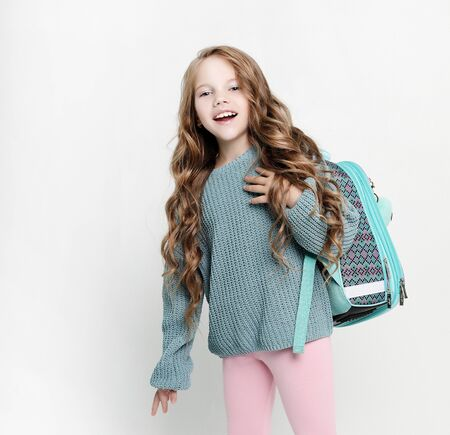 lifestyle, childhood and people concept: Portrait of smiling school girl child with backpack