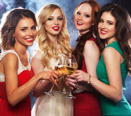 lifestyle, party and people concept - Group of partying girls clinking flutes with sparkling wine