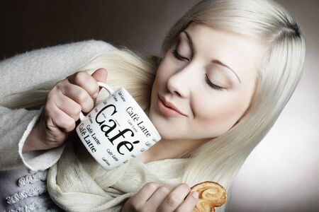 attractive woman with coffee and cookies 版權商用圖片