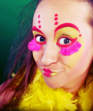 funny girl with crazy make-up close up