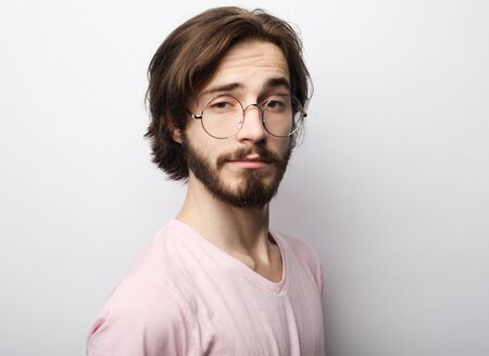 cheerful man wearing glasses, glad to find suitable well paid job Archivio Fotografico