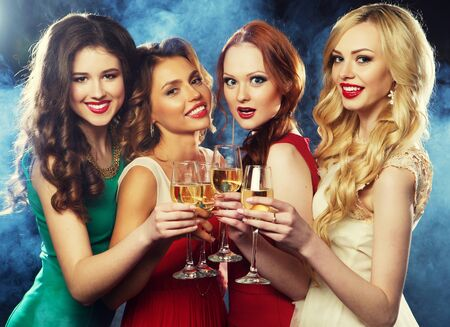 party girls clinking flutes with sparkling wine Imagens