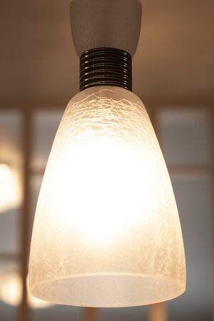 small sconce lamp, close up picture, warm tones