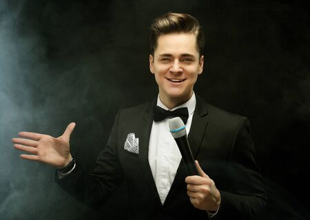 Young handsome man with microphone