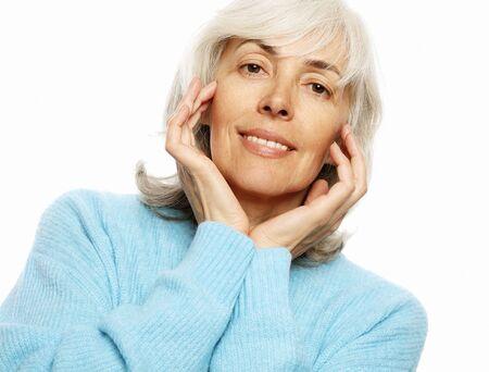 Elderly happy woman wearing blue sweater