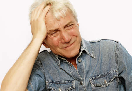 lifestyle, health and people concept: Senior man has headache, on white background