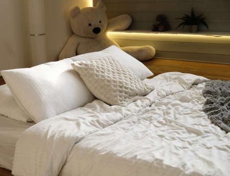 bed in the bedroom, white pillows and cozy linens, close up