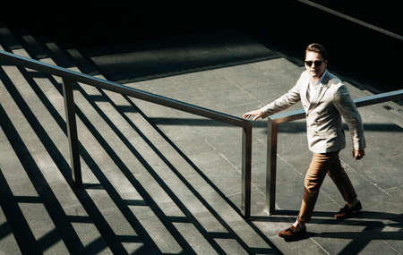 Young Business man going up the stairs