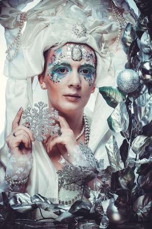 Winter beauty woman. Holiday makeup.