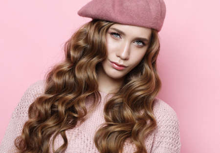 lifestyle, beauty and people concept: Beauty girl with curly perfect hairstyle wearing pink beret